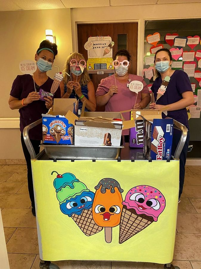 "Staff members at The Village at Victory Lakes, from left, Kelsie Morway, Peggy Josupait, Liz Carberry and Katie Johnson, enjoy ice cream during a week of celebration to honor the ""health care heroes."""