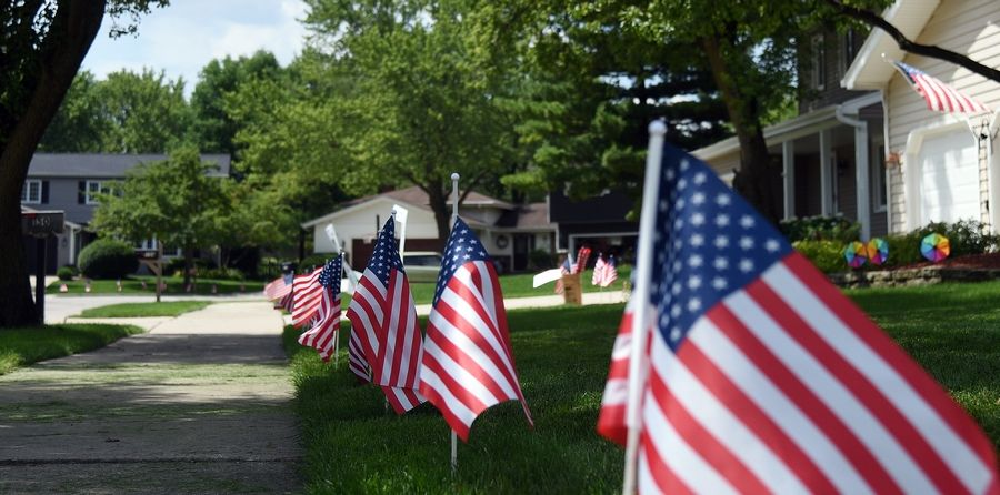 The sidewalks along S. Parkside through Dawes in Glen Ellyn are lined with flags for the Fourth of July decorating contest.