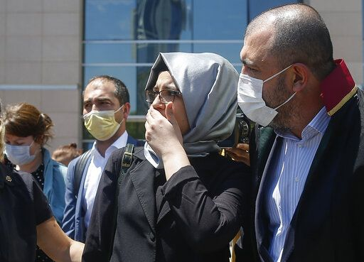 Hatice Cengiz, the fiancee of slain Saudi journalist Jamal Kashoggi, leaves a court in Istanbul, Friday, July 3, 2020, where the trial in absentia of two former aides of Saudi Crown Prince Mohammed bin Salman and 18 other Saudi nationals over the 2018 killing of the Washington Post columnist had began. Turkish prosecutors have indicted the 20 Saudi nationals over Khashoggi's grisly killing at the Saudi Consulate in Istanbul that cast a cloud of suspicion over Prince Mohammed and are seeking life prison terms for defendants who have all left Turkey. Saudi Arabia rejected Turkish demands for the suspects' extradition and put them on trial in Riyadh.