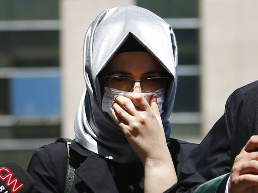 Hatice Cengiz, the fiancee of slain Saudi journalist Jamal Kashoggi, reacts as she talks to members of the media outside a court in Istanbul, Friday, July 3, 2020, where the trial in absentia of two former aides of Saudi Crown Prince Mohammed bin Salman and 18 other Saudi nationals over the 2018 killing of the Washington Post columnist had began. Turkish prosecutors have indicted the 20 Saudi nationals over Khashoggi's grisly killing at the Saudi Consulate in Istanbul that cast a cloud of suspicion over Prince Mohammed and are seeking life prison terms for defendants who have all left Turkey. Saudi Arabia rejected Turkish demands for the suspects' extradition and put them on trial in Riyadh.
