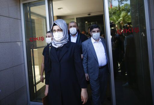 Hatice Cengiz, the fiancee of slain Saudi journalist Jamal Kashoggi, walks outside a court in Istanbul, Friday, July 3, 2020, where the trial in absentia of two former aides of Saudi Crown Prince Mohammed bin Salman and 18 other Saudi nationals over the 2018 killing of the Washington Post columnist had began. Turkish prosecutors have indicted the 20 Saudi nationals over Khashoggi's grisly killing at the Saudi Consulate in Istanbul that cast a cloud of suspicion over Prince Mohammed and are seeking life prison terms for defendants who have all left Turkey. Saudi Arabia rejected Turkish demands for the suspects' extradition and put them on trial in Riyadh.