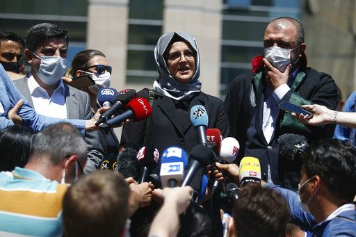 Hatice Cengiz, the fiancee of slain Saudi journalist Jamal Kashoggi, talks to members of the media outside a court in Istanbul, Friday, July 3, 2020, where the trial in absentia of two former aides of Saudi Crown Prince Mohammed bin Salman and 18 other Saudi nationals over the 2018 killing of the Washington Post columnist had began. Turkish prosecutors have indicted the 20 Saudi nationals over Khashoggi's grisly killing at the Saudi Consulate in Istanbul that cast a cloud of suspicion over Prince Mohammed and are seeking life prison terms for defendants who have all left Turkey.  Saudi Arabia rejected Turkish demands for the suspects' extradition and put them on trial in Riyadh.
