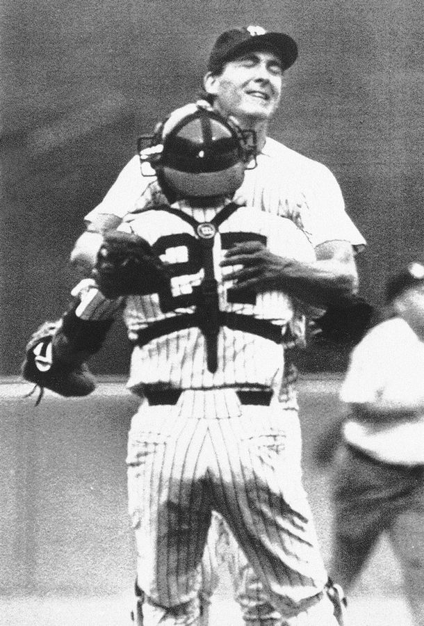 New York Yankee Dave Righetti leaps into the arms of catcher Butch Wynegar after throwing a no-hit game against the Boston Red Sox, July 5, 1983, at Yankee Stadium in New York.