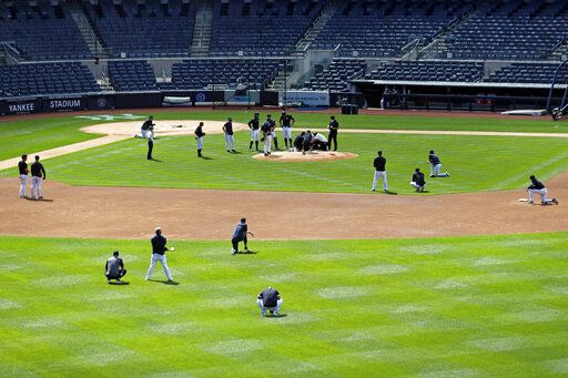 The New York Yankees team reacts after pitcher Masahiro Tanaka was hit in the head by a baseball during a team workout at Yankee Stadium in New York, Saturday, July 4, 2020.