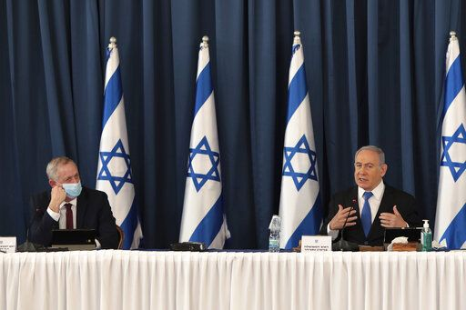 Israeli Minister of Defense and Alternate Prime Minister Benny Gantz, left and Prime Minister Benjamin Netanyahu attend the weekly cabinet meeting, at the foreign ministry, in Jerusalem, Sunday, July 5, 2020. (Photo by Gali Tibbon/Pool via AP)
