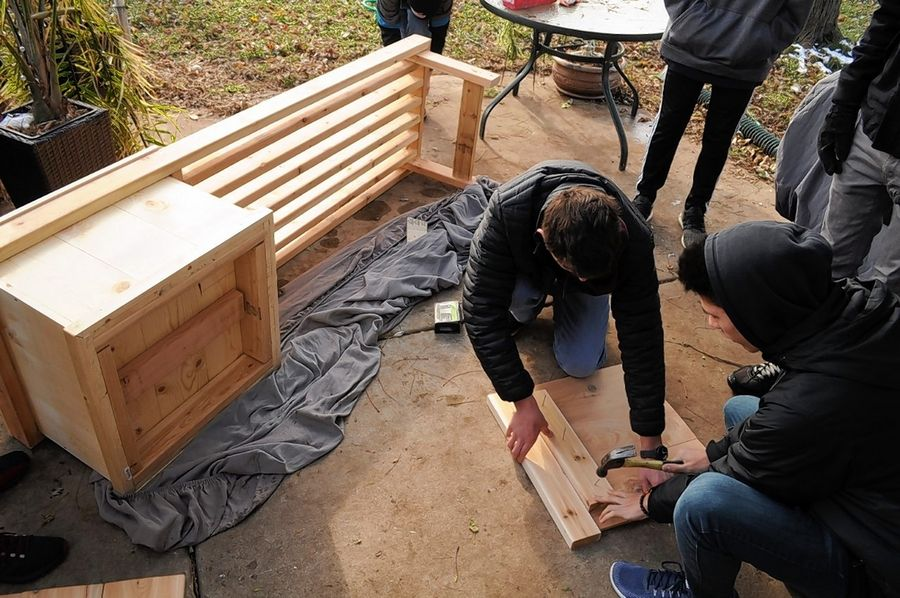 Alex Grogman of Streamwood and his team of Scouts build planter boxes for Westbrook Senior Living facility in Streamwood.