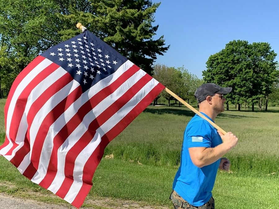 Mark Palmieri can often be seen running through the Lake County Forest Preserves carrying a large American flag. His mission is to raise awareness for veteran suicide and to honor the fallen.