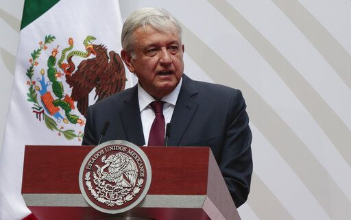 FILE - In this April 5, 2020 file photo, Mexican President Andres Manuel Lopez Obrador speaks at the National Palace in Mexico City. For his first foreign trip as president, López Obrador travels to Washington Tuesday, July 7, 2020 to meet with President Donald Trump.