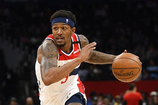FILE - In this March 8, 2020, file photo, Washington Wizards guard Bradley Beal drives during an NBA basketball game against the Miami Heat in Washington. Wizards leading scorer Bradley Beal won't take part in the restart of the NBA season because of a right rotator cuff injury.