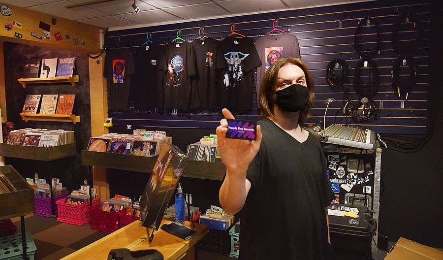 Colin Sicker manages Purple Dog Records on Wednesday on its second day in downtown Naperville. Purple Dog opened in 2014, as a family business run by father Joel Sicker, daughter Erin Gavin and son Colin Sicker and it moved this week into a new space on an alley off Washington Street.