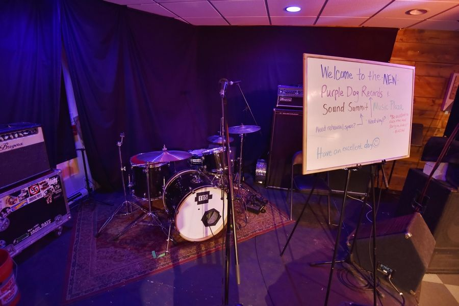 A stage for concerts takes up some of the space inside the new downtown Naperville location of Purple Dog Records at 231 S. Washington St., suite 2015.