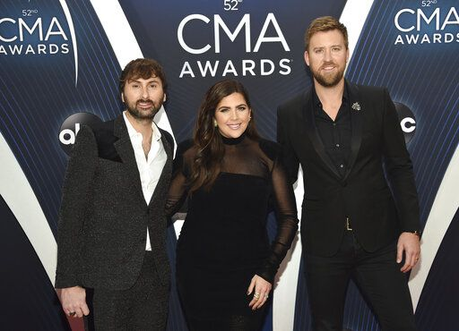"FILE - In this Nov. 14, 2018 file photo, Dave Haywood, from left, Hillary Scott and Charles Kelley, of Lady A, formerly Lady Antebellum, arrive at the 52nd annual CMA Awards in Nashville, Tenn. The Grammy-winning country group, which dropped the word ""Antebellum"" from their name because of the word's ties to slavery, has filed a lawsuit against a Black singer who has used the stage name for years. The vocal group filed the lawsuit on Wednesday in federal court in Nashville after negotiations with Anita White broke down in recent weeks. (Photo by Evan Agostini/Invision/AP, File)"