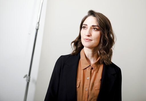 "FILE - This March 26, 2019 photo shows musician Sara Bareilles posing for a portrait in New York. Bareilles' latest project, ""Little Voice"" premieres Friday on the streaming service Apple TV+. The show follows a young singer played by Brittany O'Grady as she navigates life and love while attempting to pursue her musical dreams. (Photo by Brian Ach/Invision/AP)"