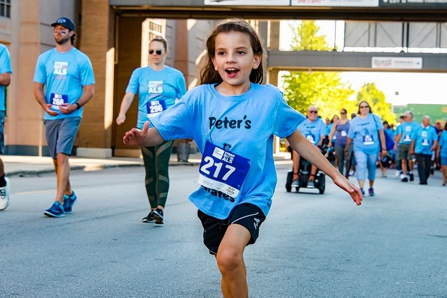 A young runner takes part in the annual Strike Out ALS 5K and 1 Mile Run, Walk & Roll to benefit the Les Turner ALS Foundation. This year's event will take place virtually July 16.
