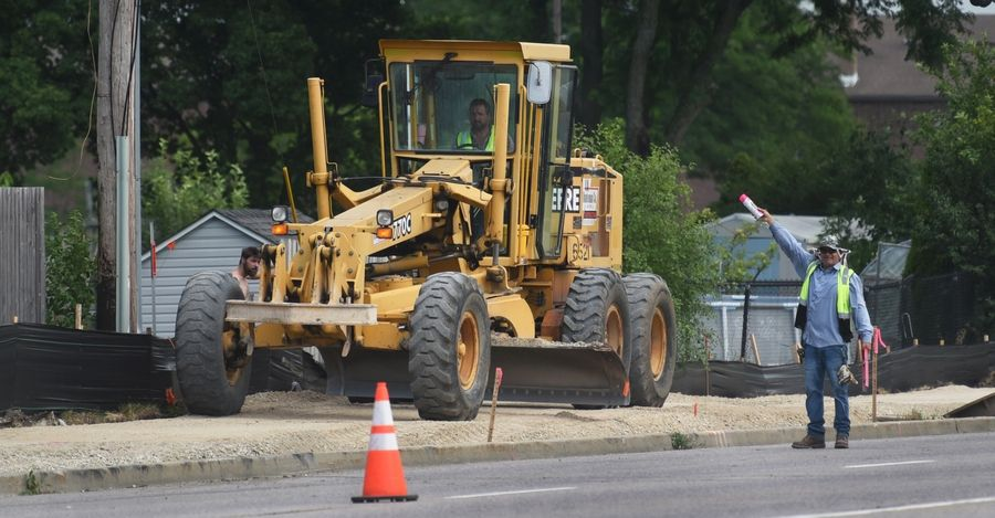 A road grader levels gravel on a new bike trail being constructed along Gary Avenue just south of Hiawatha Drive in Carol Stream Monday morning. DuPage County is constructing the 2.2-mile trail that will connect to the Great Western Trail.