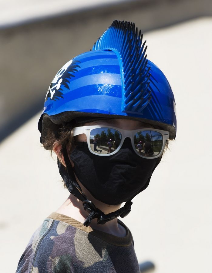 Mason Lichtenstein, 10, of Deerfield wears protective gear while riding his skateboard at the Techny Prairie Park and Fields skate park in Northbrook recently.