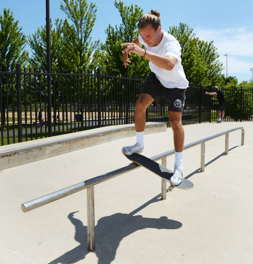 Jake Fahey of Northbrook rides a rail at the Techny Prairie Park and Fields skate park.