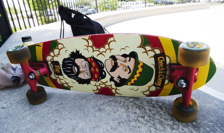 A Cheech and Chong skateboard belonging to Adrian Roberts of Schaumburg rests on a bench at the Techny Prairie Park and Fields skate park in Northbrook recently.
