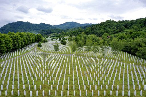 Gravestones are lined up at the memorial cemetery in Potocari, near Srebrenica, Bosnia, Tuesday, July 7, 2020. A quarter of a century after they were killed in Sreberenica, eight Bosnian men and boys will be laid to rest Saturday, July 11. Over 8,000 Bosnian Muslims perished in 10 days of slaughter after the town was overrun by Bosnian Serb forces in the closing months of the country's 1992-95 fratricidal war.