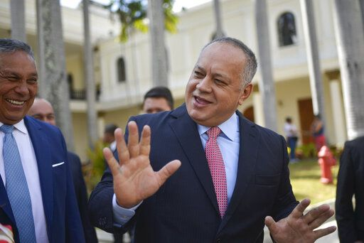 FILE- In this Jan. 8, 2020 file photo, Diosdado Cabello, president of the National Constituent Assembly, jokes with lawmakers after giving a press conference at the National Assembly in Caracas, Venezuela. Cabello has announced on Thursday, July 9, 2020, that he tested positive for COVID-19.