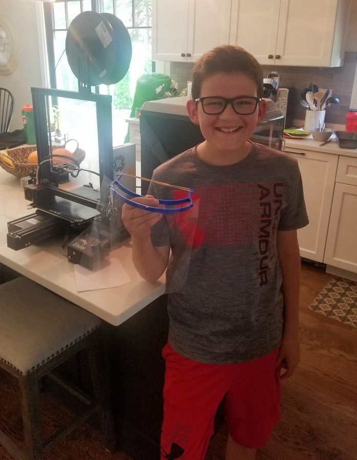 Twelve-year-old Vince Radlicz of Arlington Heights has made hundreds of face shields using 3D printers and other equipment since the pandemic hit Illinois.