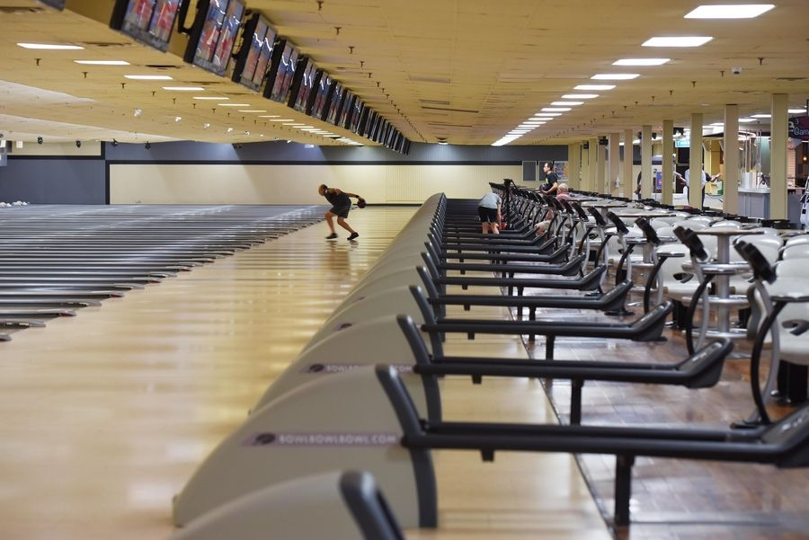 Stardust Bowl in Addison has 84 lanes but only 50 people are allowed inside at a time. Only four people were bowling Thursday morning.