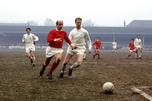 FILE - In this Jan. 11, 1969 file photo Leeds United's Jack Charlton, right, challenges his brother Manchester United's Bobby Charlton during a soccer match in Leeds, England. Jack Charlton, who won the World Cup with England in 1966, has died it was announced on Saturday July 11, 2020. He was 85.  (PA via AP)