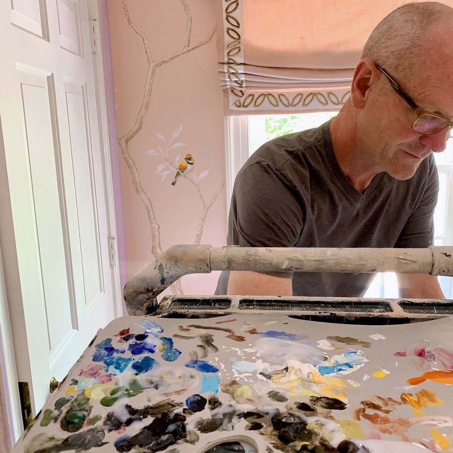 David Ryan of Rolling Meadows paints a bird motif in the girl's bedroom designed by Joey Leicht Design of Chicago for the Lake Forest Showhouse.