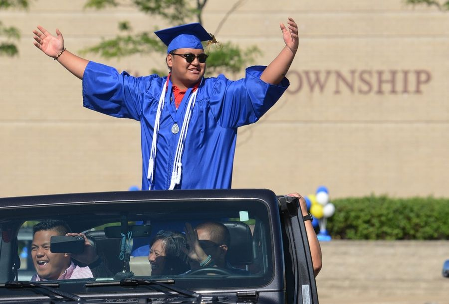 Warren Township High School graduate Nelson Ross celebrates Sunday during a drive-through commencement ceremony at the school's Almond Campus.