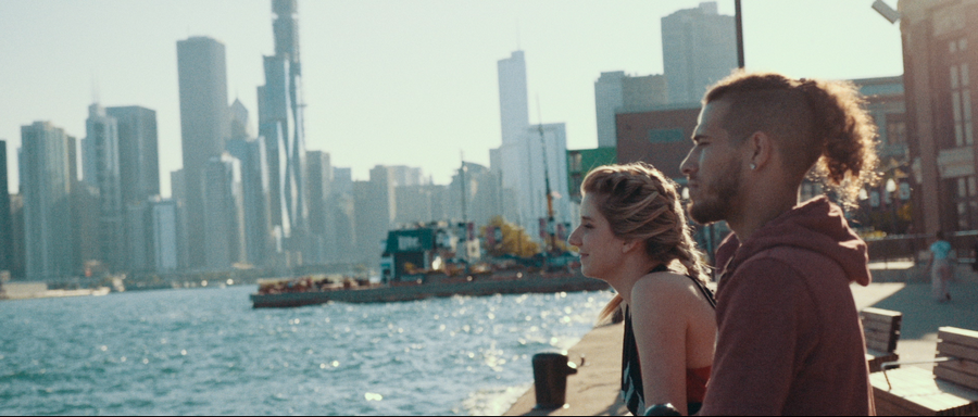 "A still image from Brina Kay's ""Heat of the Moment"" music video released on July 10. Brina Kay, left, and Andrew Haney look out at Lake Michigan from Navy Pier in Chicago."