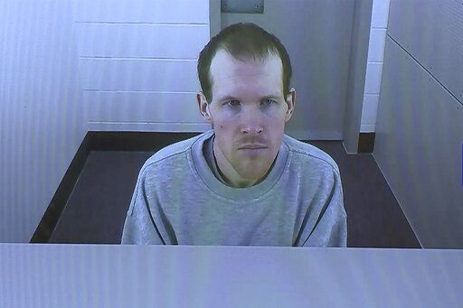 FILE - In this March 26, 2020, file image made from video, Brenton Harrison Tarrant appears in a screen via video link in Christchurch, New Zealand. The man who has admitting killing 51 worshippers in a mass shooting at two mosques in Christchurch on March 15, 2019 has dismissed his legal team and will represent himself at a sentencing hearing next month. Tarrant's sentencing hearing, delayed by the coronavirus pandemic, will begin in Christchurch on Aug. 24. (TVNZ Pool via AP, File)