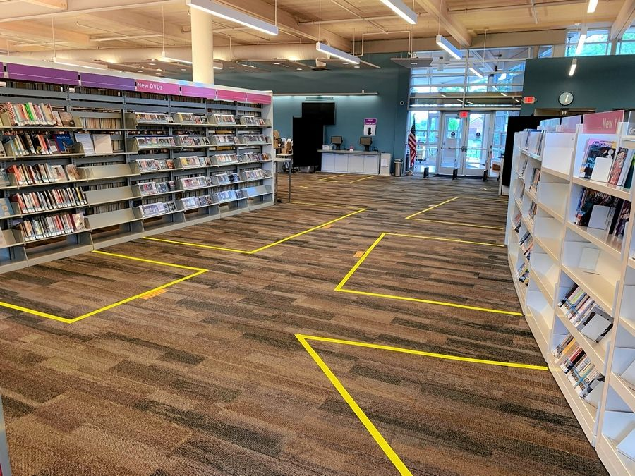Yellow tape has been added to the carpet inside the Wauconda Area Library to create personal zones and ensure social distancing.