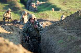 Armenian soldiers take their position on the front line in Tavush region, Armenia, Tuesday, July 14, 2020. Skirmishes on the volatile Armenia-Azerbaijan border escalated Tuesday, marking the most serious outbreak of hostilities between the neighbors since the fighting in 2016. (Armenian Defense Ministry Press Service/PanPhoto via AP)