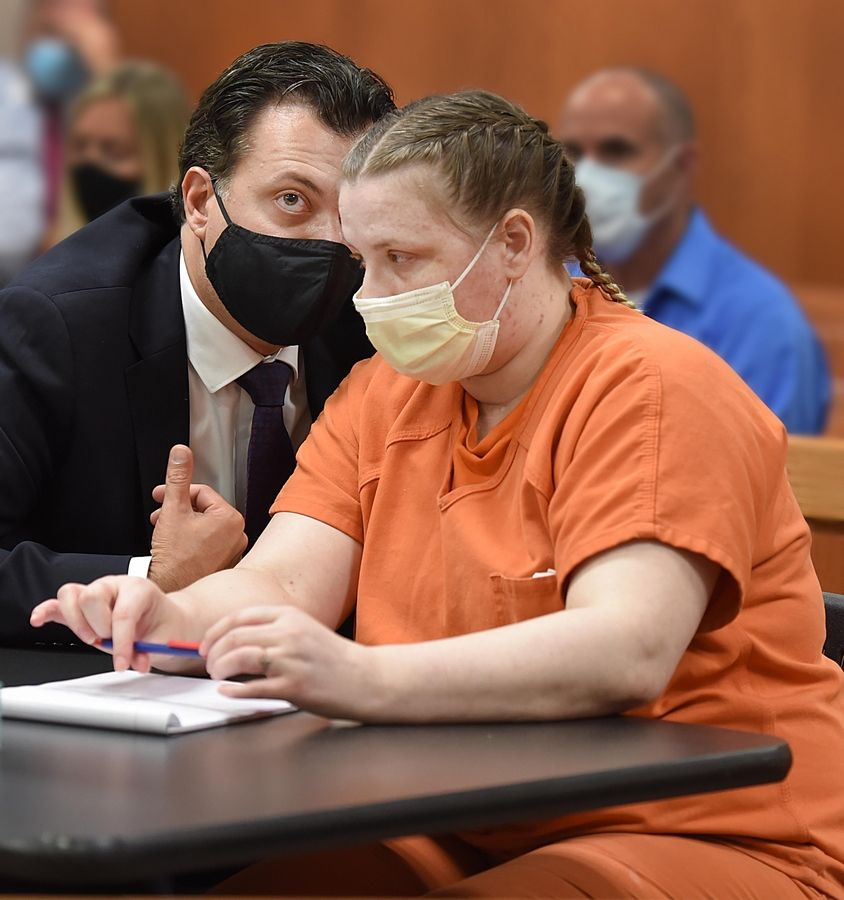 JoAnn Cunningham, 37, listens to her public defender, Angelo Mourelatos, during her sentencing hearing Thursday in Woodstock. Cunningham pleaded guilty in December to killing her 5-year-old son A.J. Freund Jr. in April, 2019 in her Crystal Lake home. His body was found in a shallow grave in Woodstock.