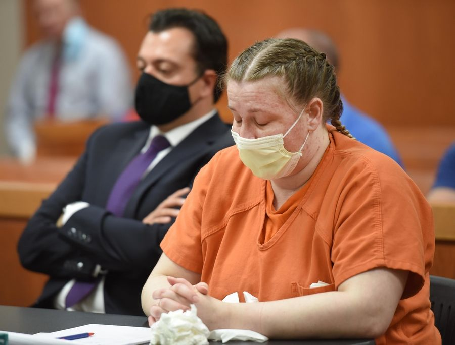 JoAnn Cunningham, 37, closes her eyes as video recordings are played Thursday during her sentencing hearing in Woodstock. She pleaded guilty in December to killing her 5-year-old son A.J. Freund Jr. in April, 2019 in her Crystal Lake home. Behind her is her Angelo Mourelatos, her court-appointed attorney.