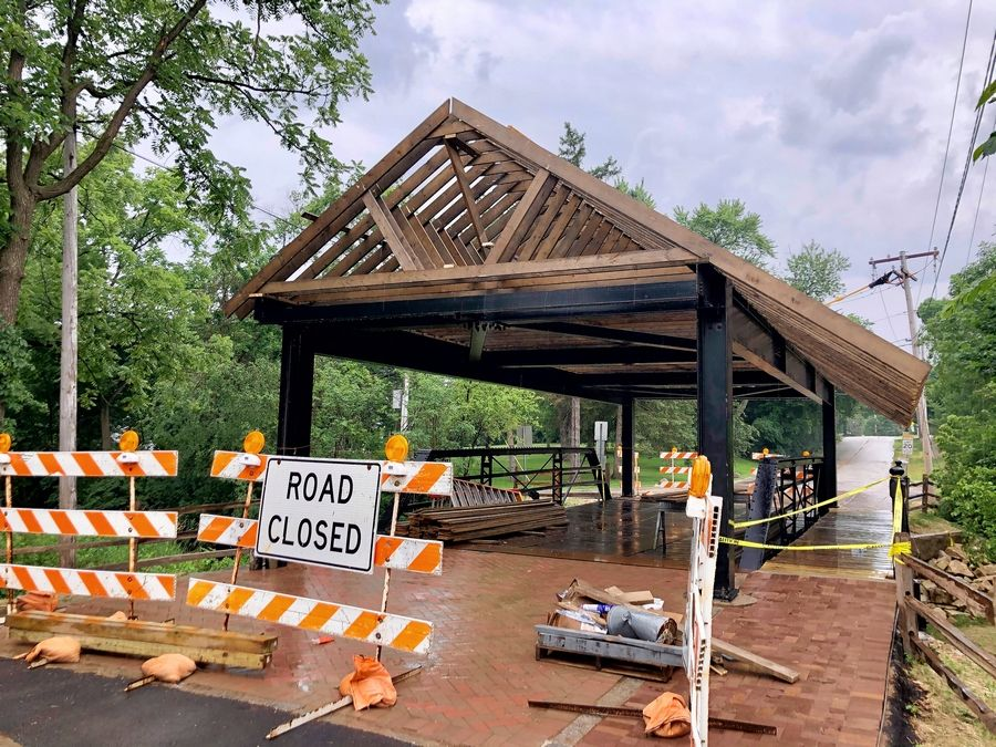 Long Grove's 114-year-old bridge on the National Register of Historic Places is getting close to having its signature timber cover back on.