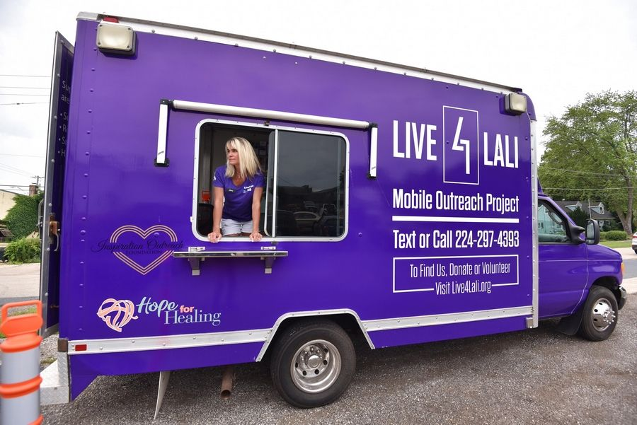 Stacy Harding staffs the Stigma Crusher, a van operated by the Arlington Heights-based nonprofit Live4Lali to distribute free harm reduction supplies to people who use drugs.