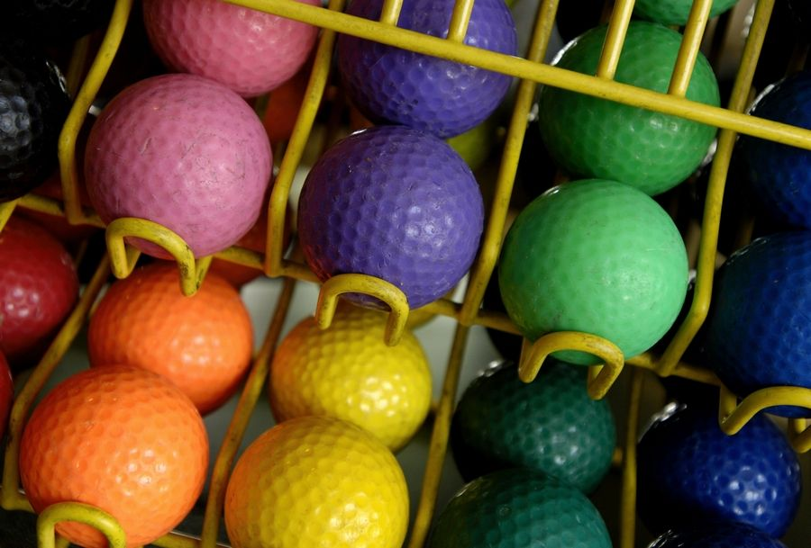 Extra cleaning precautions have been put in place at area miniature golf courses amid the coronavirus pandemic. A rack of colorful golf balls at the Green Valley Golf Range awaits mini golfers.