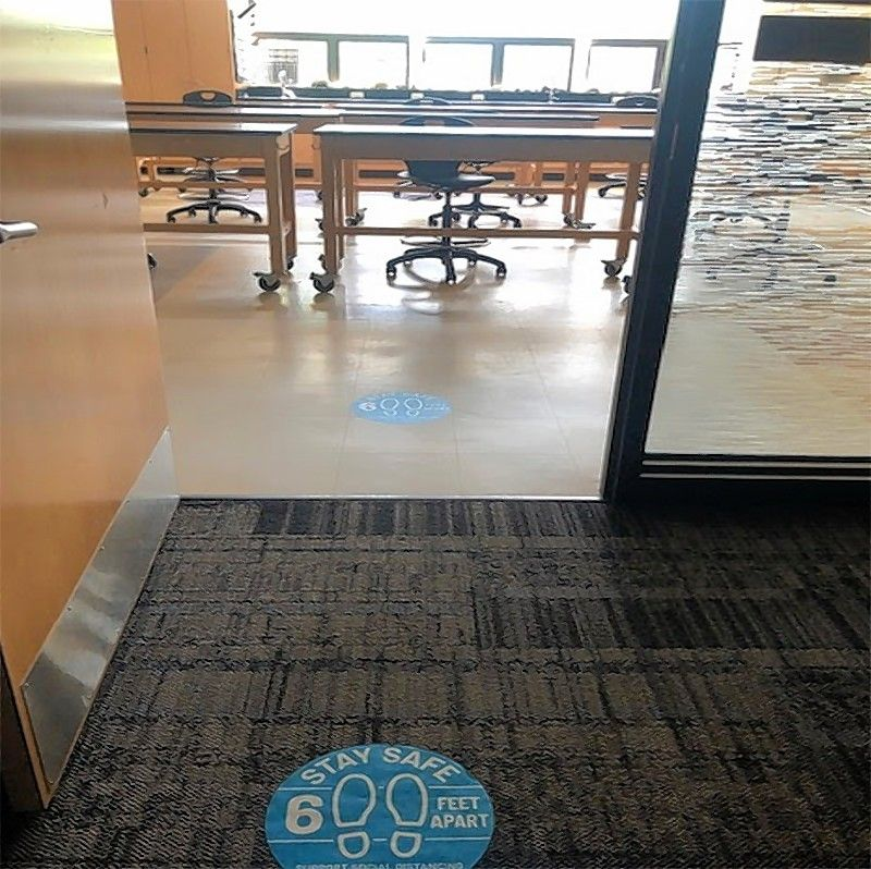 Decals have been applied to the floors and carpets at Stevenson High School to remind students and staffers to stay at least 6 feet apart from each other. Even so, remote learning will resume when the 2020-21 school year begins.