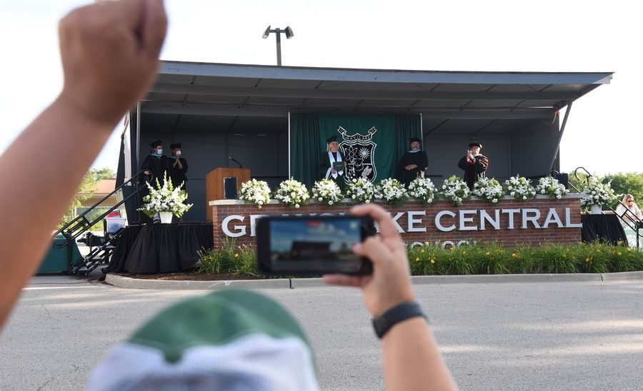 Family and friends cheer for Grayslake Central High School grad Caleb Patrick during Wednesday night's socially distanced ceremony at the school.
