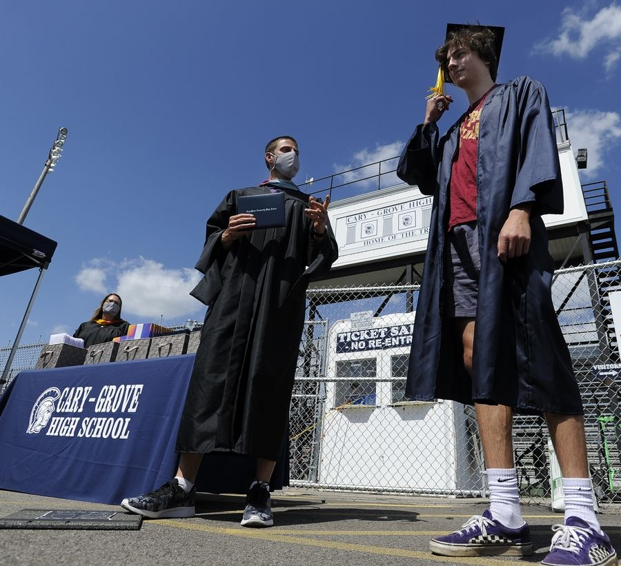 Eamon Gleason, 18, gets ready to receive his diploma from Cary-Grove High School Principal Neil Lesinski Friday.
