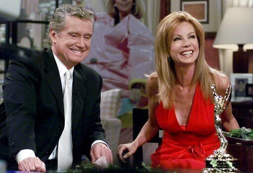FILE - In this July 28, 2000 file photo, Kathie Lee Gifford and co-host Regis Philbin reminisce during her last appearance on the show, in New York. Philbin, the genial host who shared his life with television viewers over morning coffee for decades and helped himself and some fans strike it rich with the game show 'œWho Wants to Be a Millionaire,'� has died on Friday, July 24, 2020.