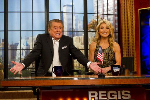 "FILE - In this Nov. 18, 2011 file photo, Regis Philbin and Kelly Ripa appear on Regis' farewell episode of ""Live! with Regis and Kelly"", in New York.  Philbin, the genial host who shared his life with television viewers over morning coffee for decades and helped himself and some fans strike it rich with the game show 'œWho Wants to Be a Millionaire,'� has died on Friday, July 24, 2020."