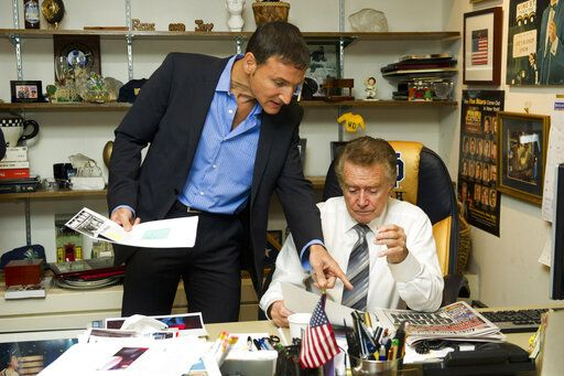 "FILE - In this Oct. 28, 2011 file photo, Regis Philbin, right, and producer Michael Gelman go over show prep in Regis's office before a broadcast of ""Live! with Regis and Kelly"", in New York.  Philbin, the genial host who shared his life with television viewers over morning coffee for decades and helped himself and some fans strike it rich with the game show 'œWho Wants to Be a Millionaire,'� has died on Friday, July 24, 2020."