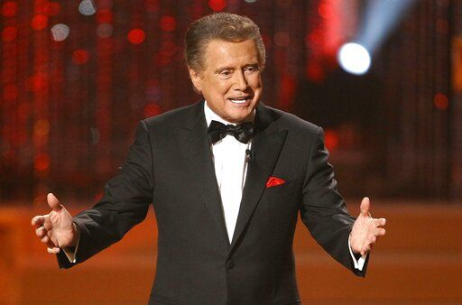FILE - In this June 27, 2010 file photo, host Regis Philbin is seen on stage at the 37th Annual Daytime Emmy Awards in Las Vegas.  Philbin, the genial host who shared his life with television viewers over morning coffee for decades and helped himself and some fans strike it rich with the game show 'œWho Wants to Be a Millionaire,'� has died on Friday, July 24, 2020.