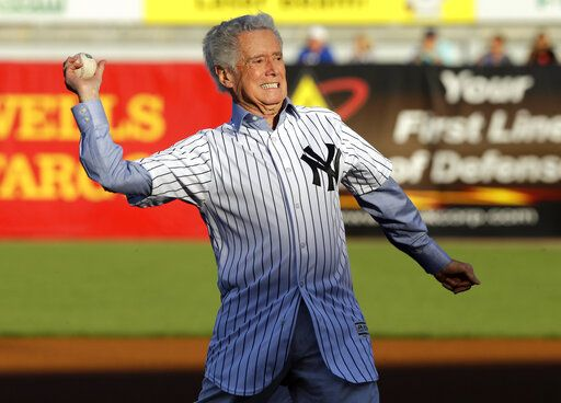 FILE - In this March 22, 2016 file photo,Regis Philibin throws out the ceremonial first pitch before a spring training baseball game between the New York Yankees and the New York Mets in Tampa, Fla.  Philbin, the genial host who shared his life with television viewers over morning coffee for decades and helped himself and some fans strike it rich with the game show 'œWho Wants to Be a Millionaire,'� has died on Friday, July 24, 2020.