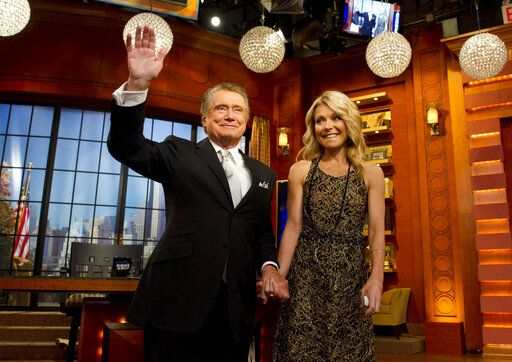 "FILE - In this Friday, Nov. 18, 2011, file photo, Regis Philbin and Kelly Ripa appear on Regis' farewell episode of ""Live! with Regis and Kelly"", in New York.  Philbin, the genial host who shared his life with television viewers over morning coffee for decades and helped himself and some fans strike it rich with the game show 'œWho Wants to Be a Millionaire,'� has died on Friday, July 24, 2020."