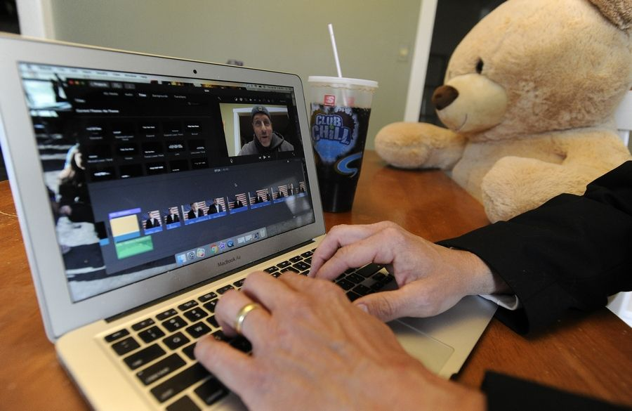 A suburban teacher works on a weekly video for his fifth-grade class.