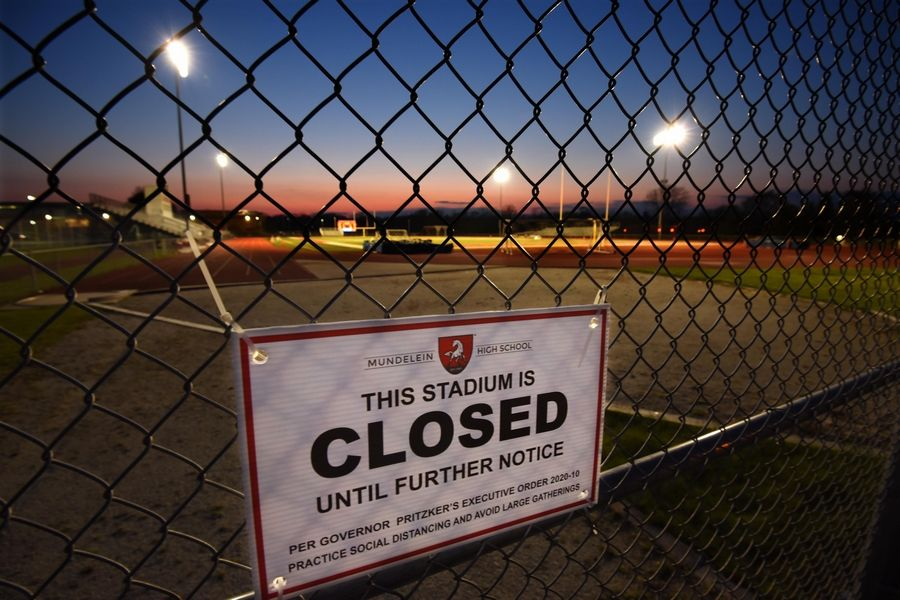 The stadium lights won't be turned on at Illinois high schools for football this fall.