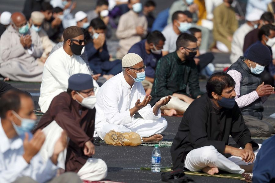 Hundreds of Muslims attended Eid al-Adha congregational prayers Friday in the parking lot of the Schaumburg Boomers Stadium organized by Masjid al-Huda in Schaumburg.